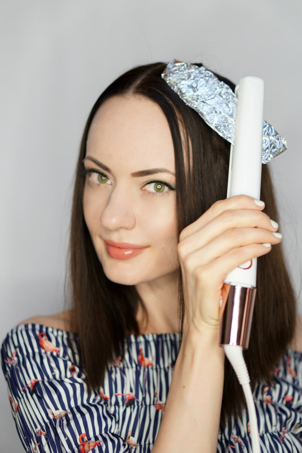 StyleSprinter - How To Curl Your Hair Using A Flat Iron And Aluminum Foil - 6