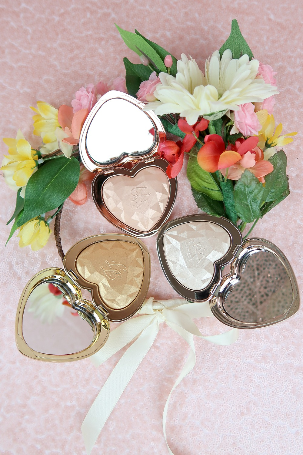 Too Faced Love Light Prismatic Highlighters Review and Swatches