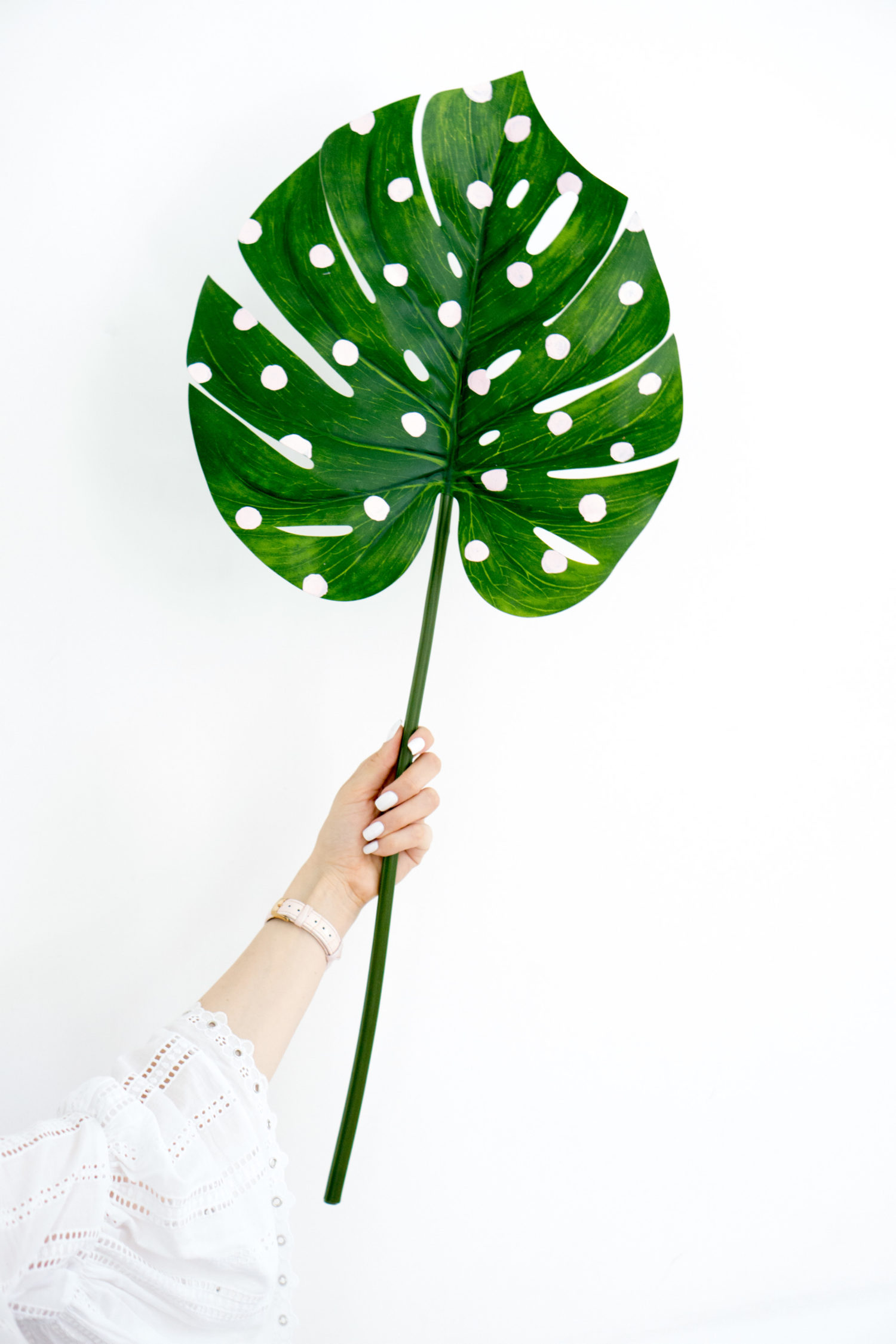 DIY dorm decor idea - pink polka dot palm leaves